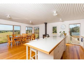 View profile: soak in the views from this charming Queenslander
