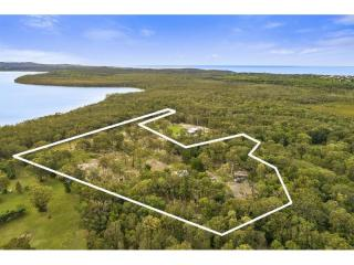 View profile: massive opportunity -10 flat acres with private sandy beach